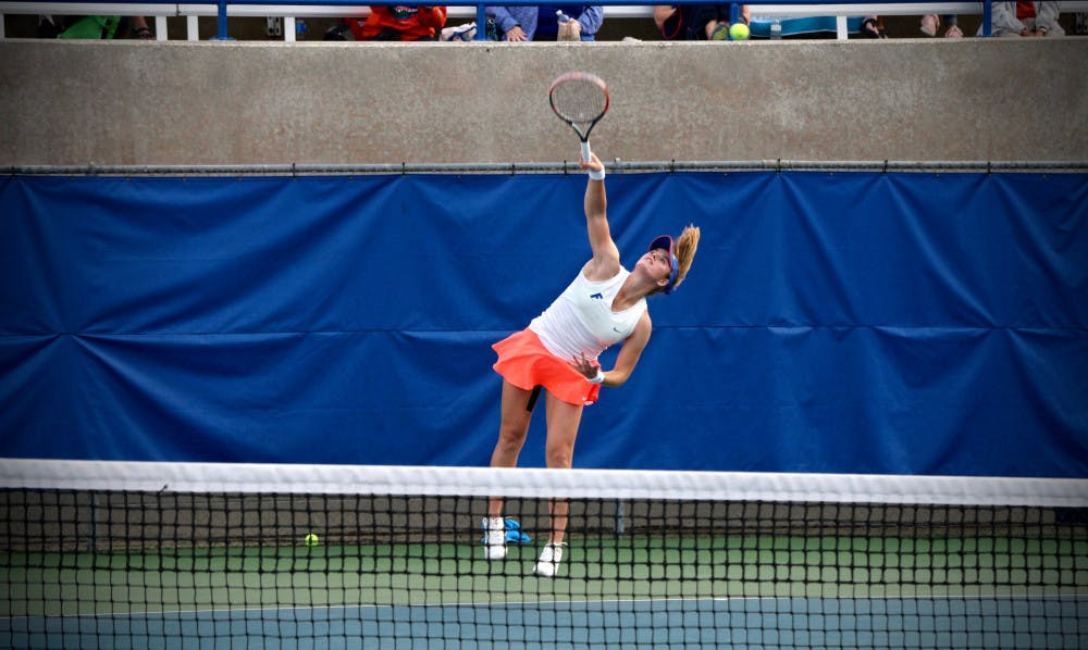 <p>Belinda Woolcock serves during Florida's 4-2 win against Oklahoma State on Feb. 18, 2017, at the Ring Tennis Complex.</p>