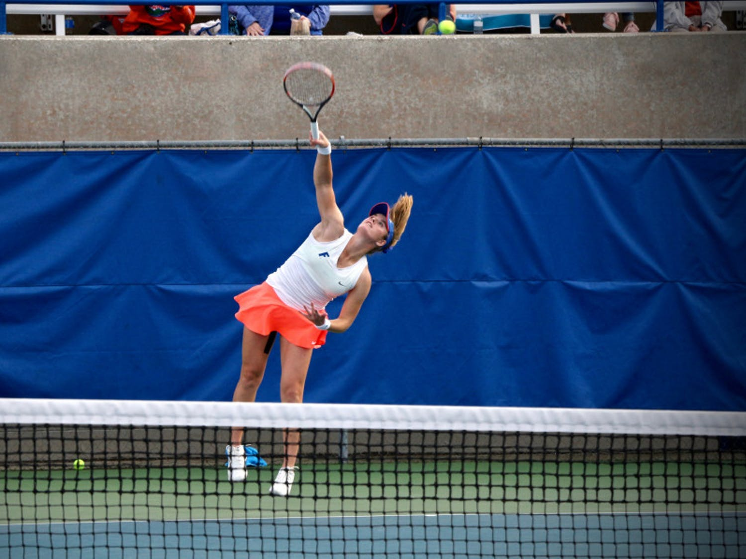 Belinda Woolcock serves during Florida's 4-2 win against Oklahoma State on Feb. 18, 2017, at the Ring Tennis Complex.