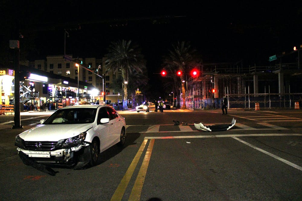 <p>A white Honda Accord involved in the car crash on West University Avenue that killed Sophia Lambert's and hospitalized five others on Saturday, Jan. 16, 2021. A memorial service in honor of Lambert was held at the Chabad UF Jewish Center on Friday, Jan. 22, 2021.</p>