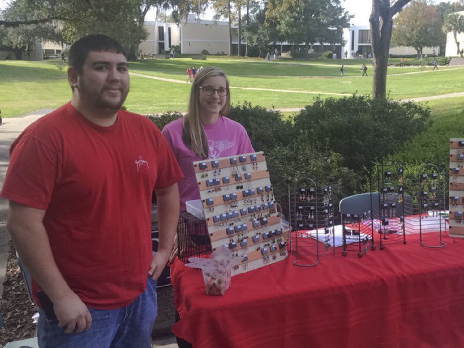 Tyler Welz (left), a 22-year-old Santa Fe nursing senior, and Caroline Lewis, a 21-year-old Santa Fe nursing senior, sell earrings on Nov. 30, 2015, outside Santa Fe's food court to fund a trip to the Nursing Student Association's annual convention in Orlando. The earring sale ends today at 2 p.m.