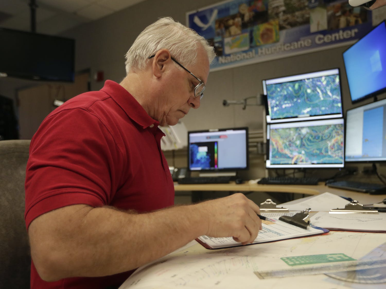 Senior hurricane specialist Stacy Stewart monitors the progress of Tropical Storm Dorian at the National Hurricane Center, Tuesday, in Miami.