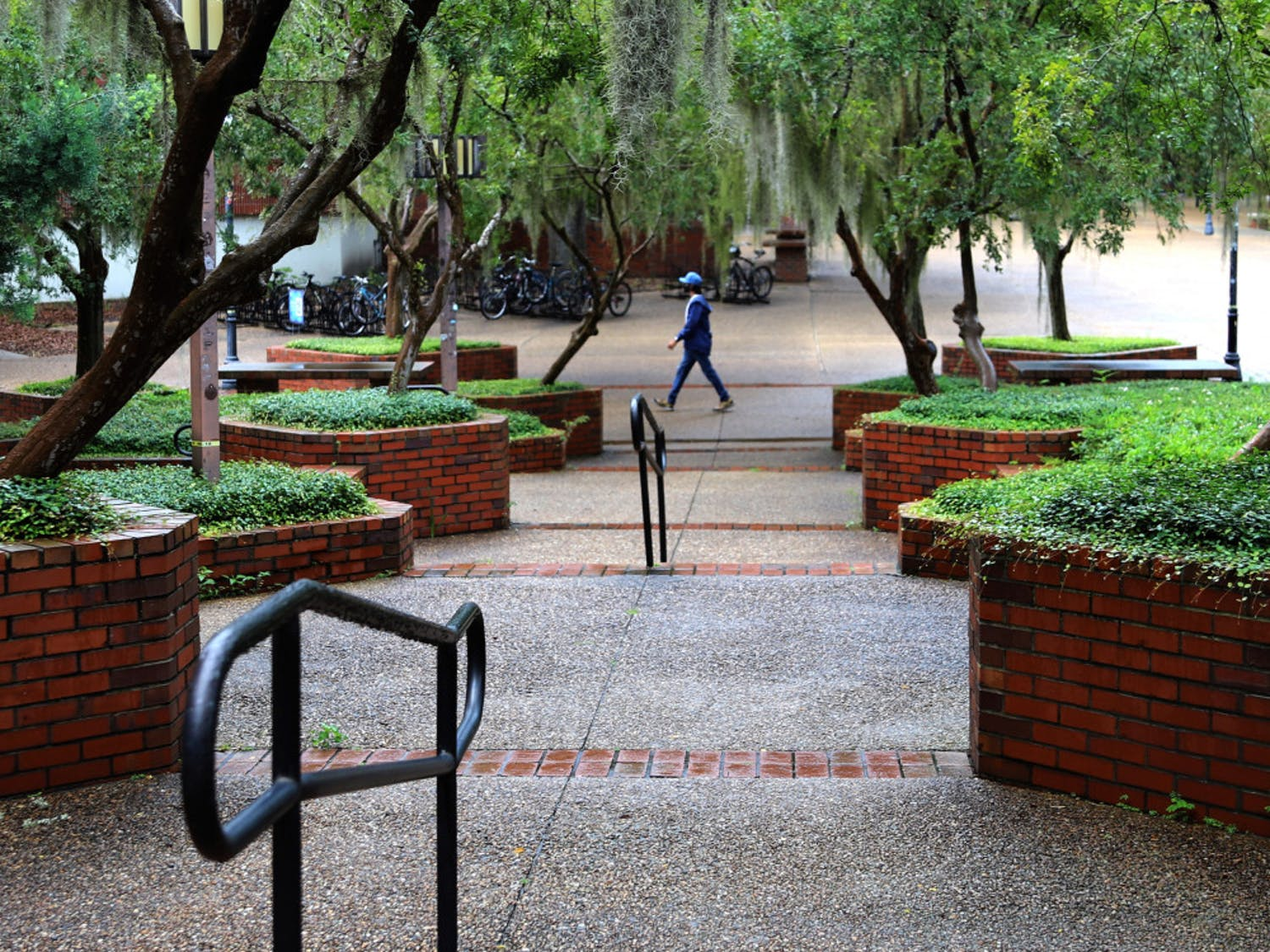 A lone man is seen walking through Turlington Plaza at UF in Gainesville, Fla., on August 31, 2020. The plaza, which is usually filled with people, remained relatively bare on the first day of fall classes.