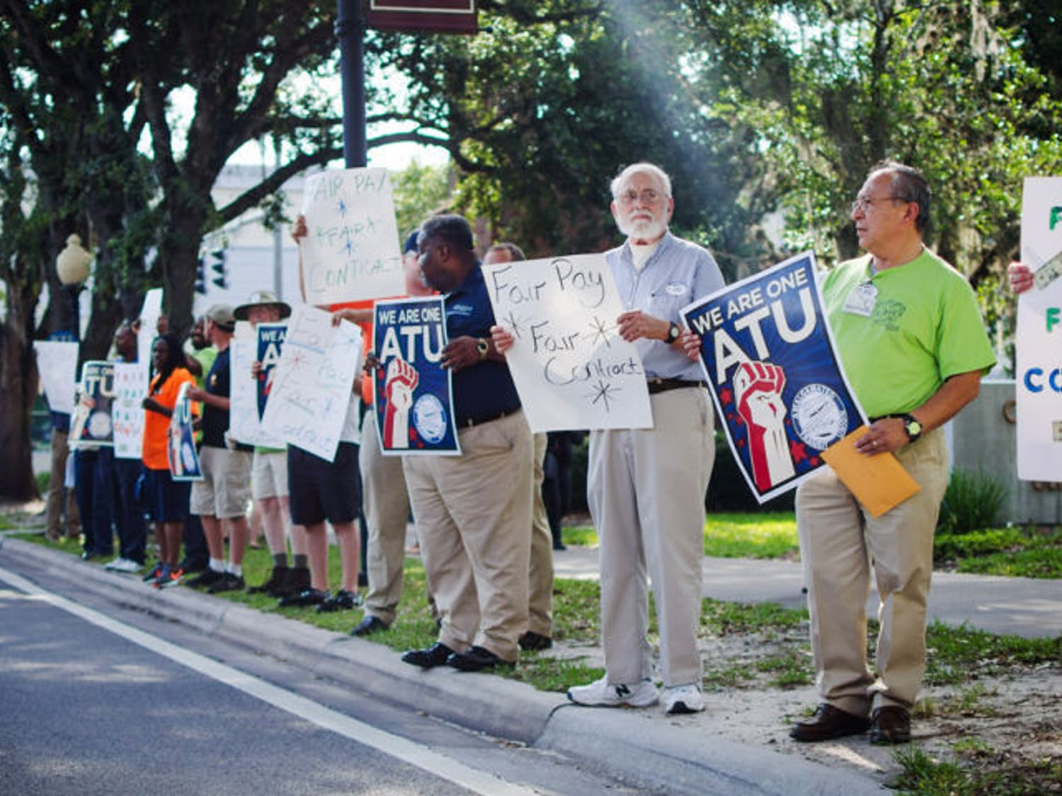 Power to the People - Antonio Cruz, 59, pictured right, joined the Amalgamated Transit Union in rallying support for the fair pay of RTS employees outside city hall on Thursday . Soon thereafter, the AT Union voiced their concerns at the city commission meeting.