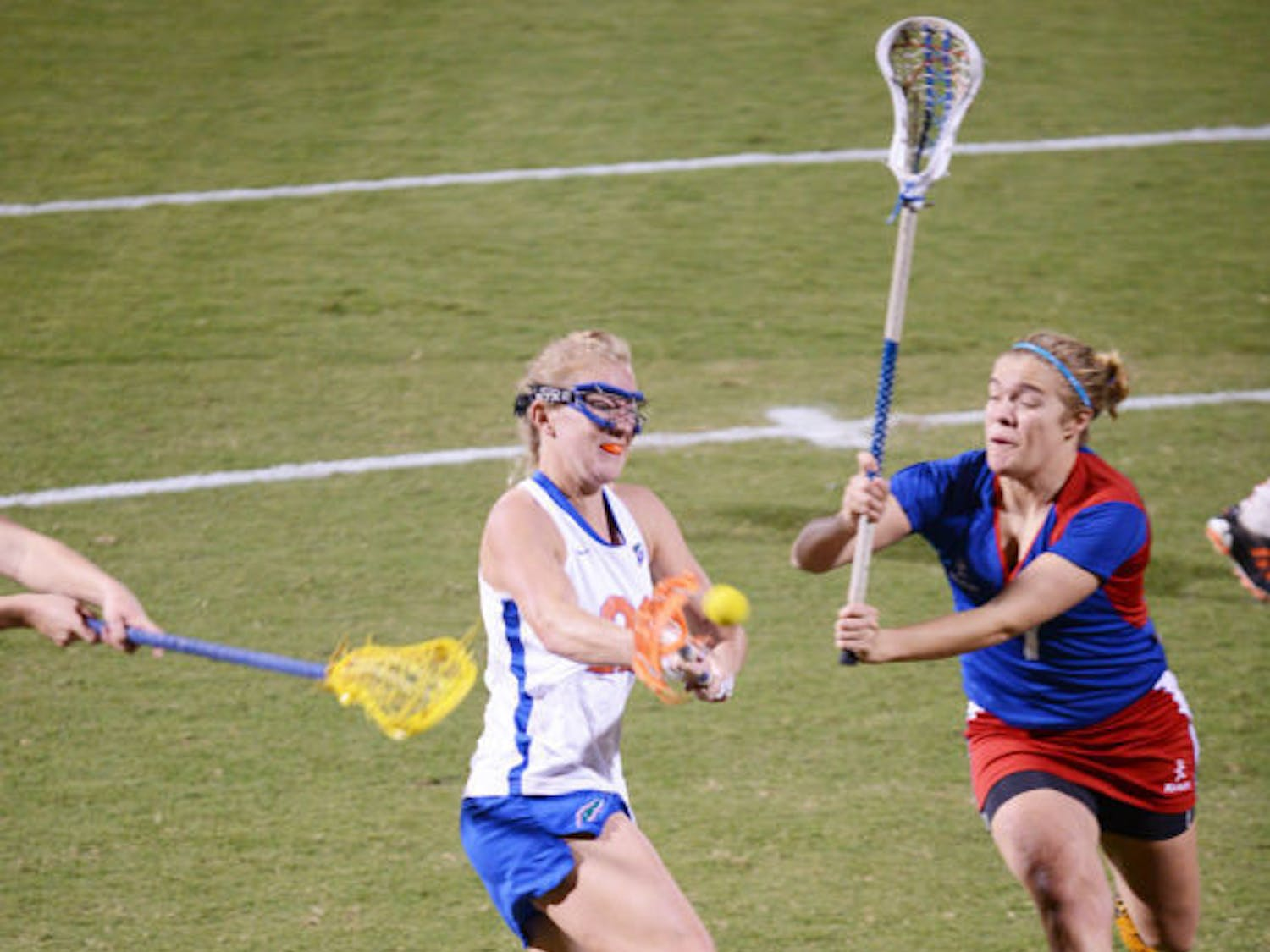 Senior Brittany Dashiell (left) attempts a shot during Florida's 18-13 exhibition win against England on Jan. 24 at Dizney Stadium. Dashiell and the Gators defeated Stony Brook 16-9 on Wednesday.