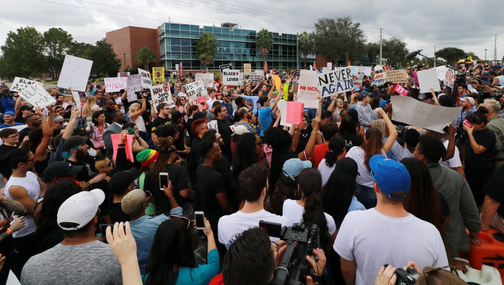 """<p><span id=""""docs-internal-guid-ce41109c-38c9-a5df-ff95-cac5f9b2ba6d""""><span>Hundreds of protesters yell, chant and display signs on their initial approach to the Phillips Center for the Performing Arts on Thursday.</span></span></p>"""