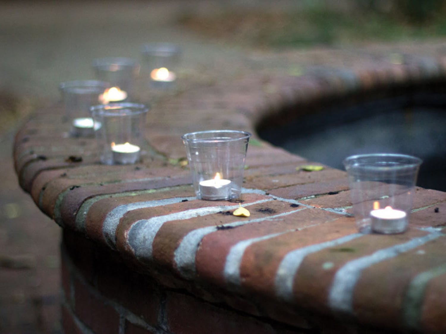 A candlelight vigil in honor of Victims' Rights Week was held at the United Church of Gainesville on Wednesday. Attendees lit candles in remembrance of those they had lost and placed their candles on a fountain in the courtyard.
