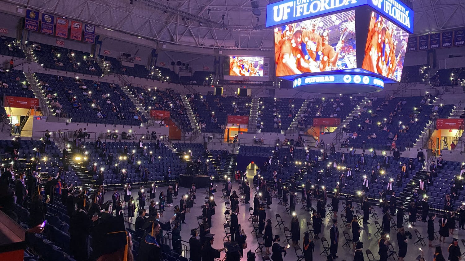 "UF graduates stand and sing along to Tom Petty's ""I Won't Back Down"" during the 2021 graduation ceremony on Saturday, May 1, 2021. (Photo by Makiya Seminera)"