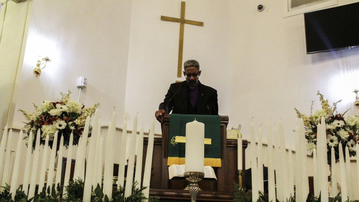 Rev. Milford Griner, a local pastor, community leader and advocate, speaks to the audience on the importance of fighting the racism that continues to pervade society today at the Mount Pleasant United Methodist Church memorial service Friday evening.