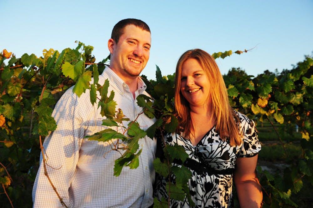 <p>Bradley and Jennifer Ferguson pose in their vineyard, Bluefield Estate Winery, on Wednesday.</p>