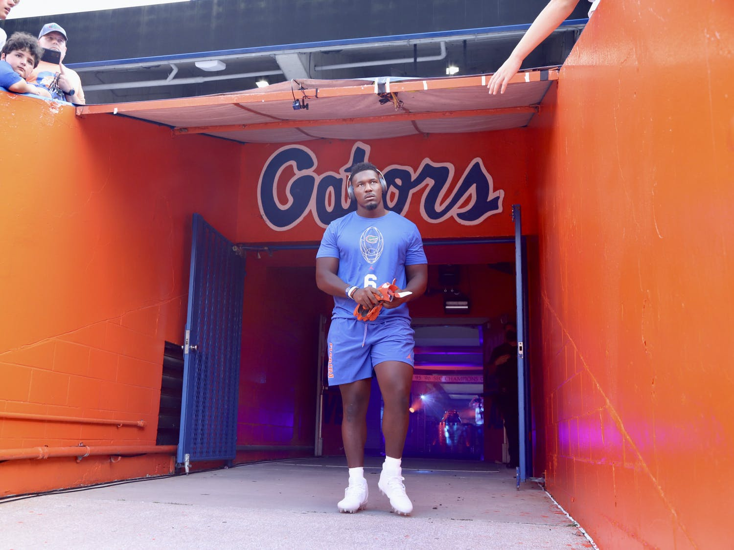 Florida defensive end Zachary Carter walks on to the field at Ben Hill Griffin Stadium for warmups ahead of the Gators' season opener against Florida Atlantic on Sept. 4.