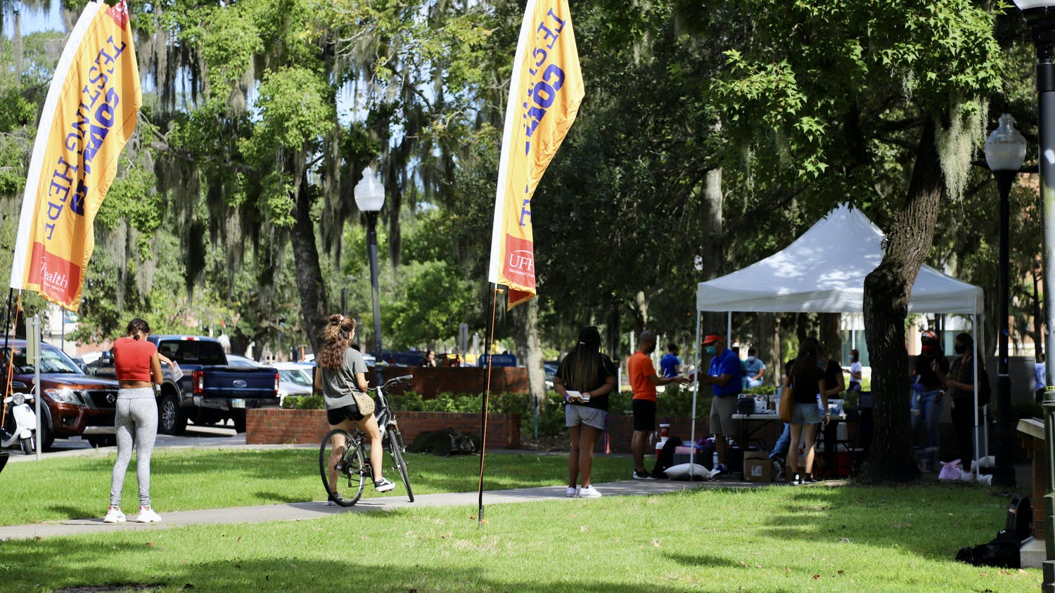Students are seen waiting in line to be tested at the COVID-19 testing site outside of Murphee Hall on Sept. 24, 2020. Students who wish to get tested are required to fill out an online screening questionnare prior to making an appointment and are asked to bring their Gator One ID card.