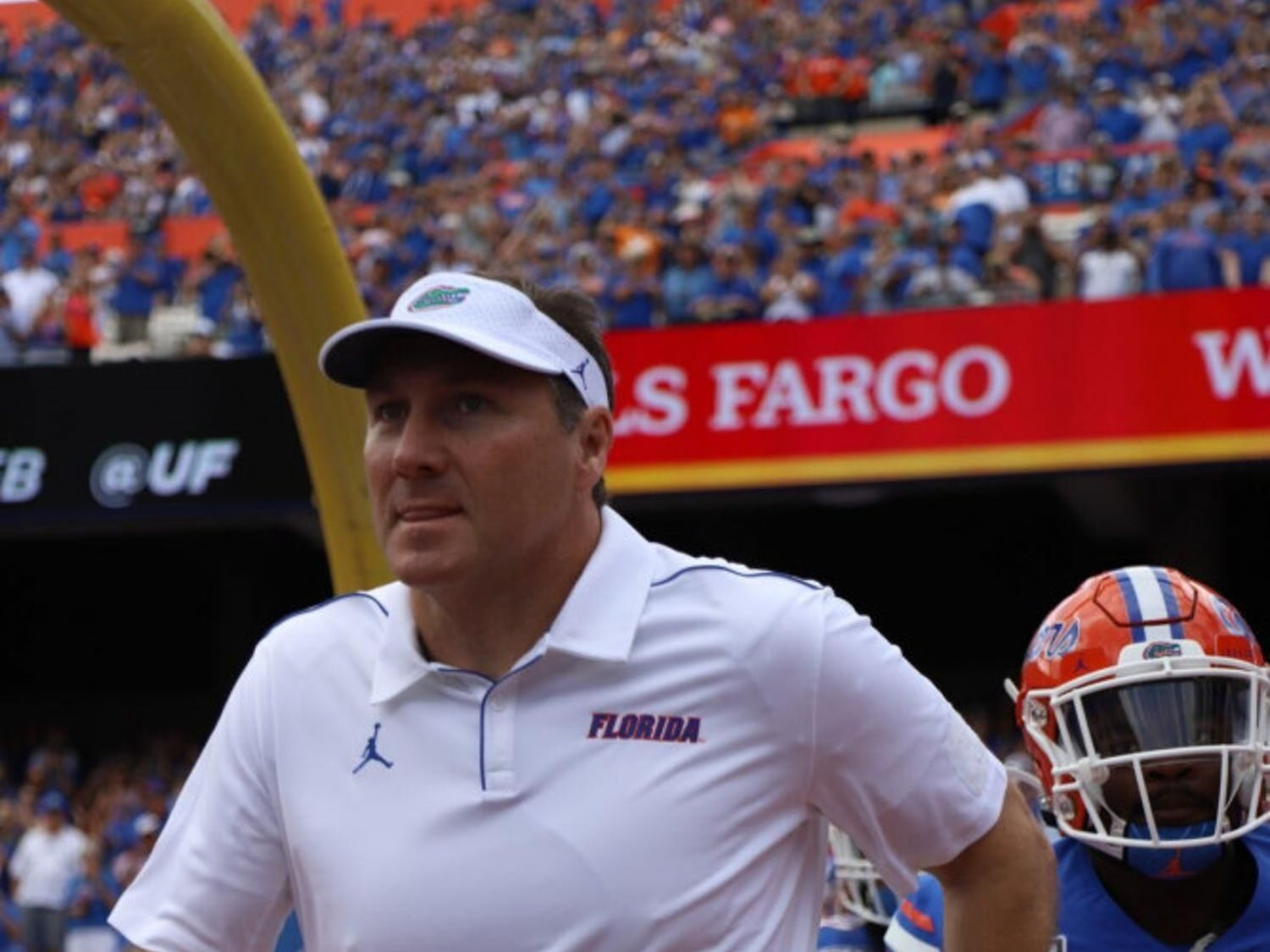 Mullen admitted fault on a recruiting violation and a failure to comply with NCAA investigations.