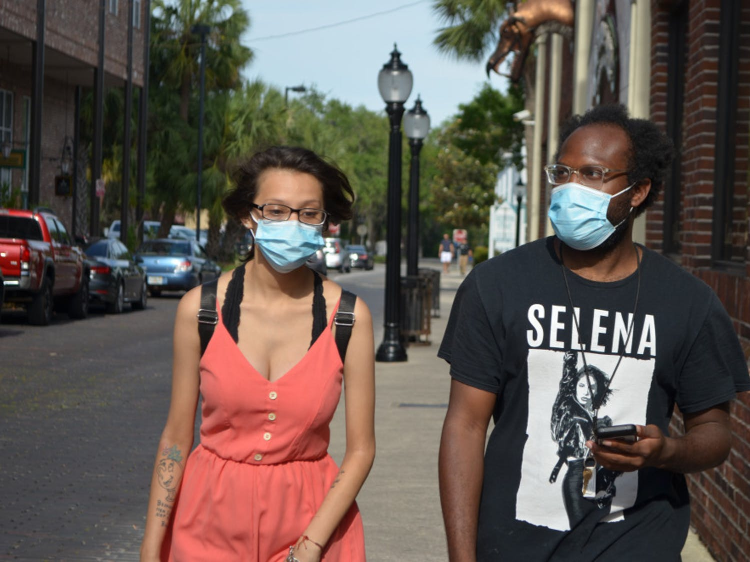 Denise Garcia and Jeffery Davis wear face masks in downtown Gainesville.