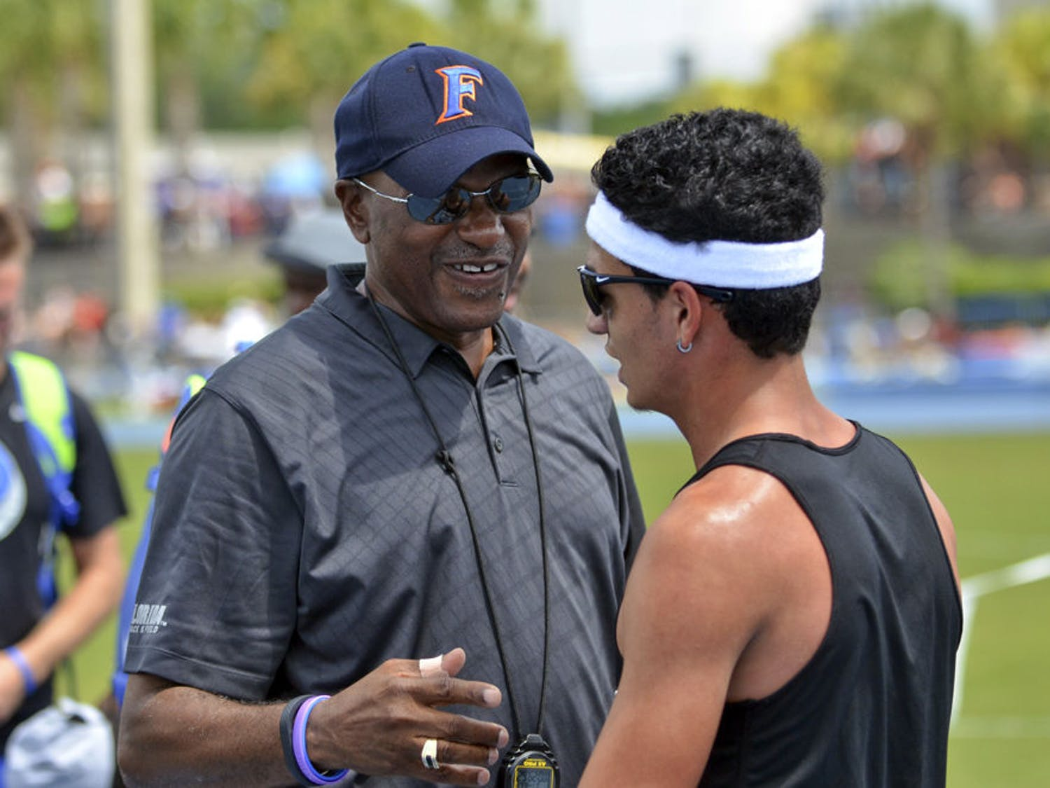 UF coach Mike Holloway talks with Andres Arroyo during the Florida Relays on April 4, 2015, at the Percy Beard Track.