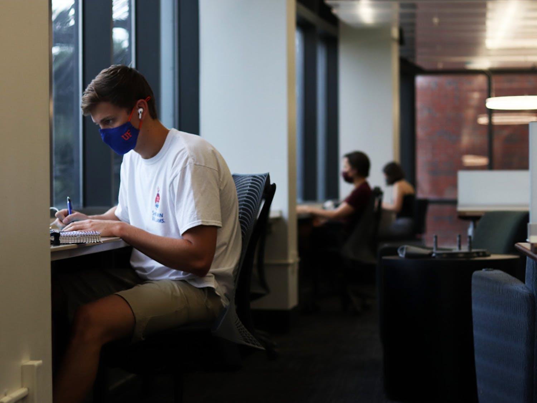 Jack Kuehler, 20, (left) a UF business administration junior studies in Library West on Friday, Sept. 11, 2020. (Lauren Witte/Alligator Staff)