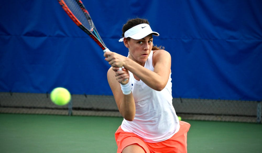 <p>Ingrid Neel returns a ball during Florida's 4-2 win against Oklahoma State on Feb. 18, 2017, at the Ring Tennis Complex.</p>