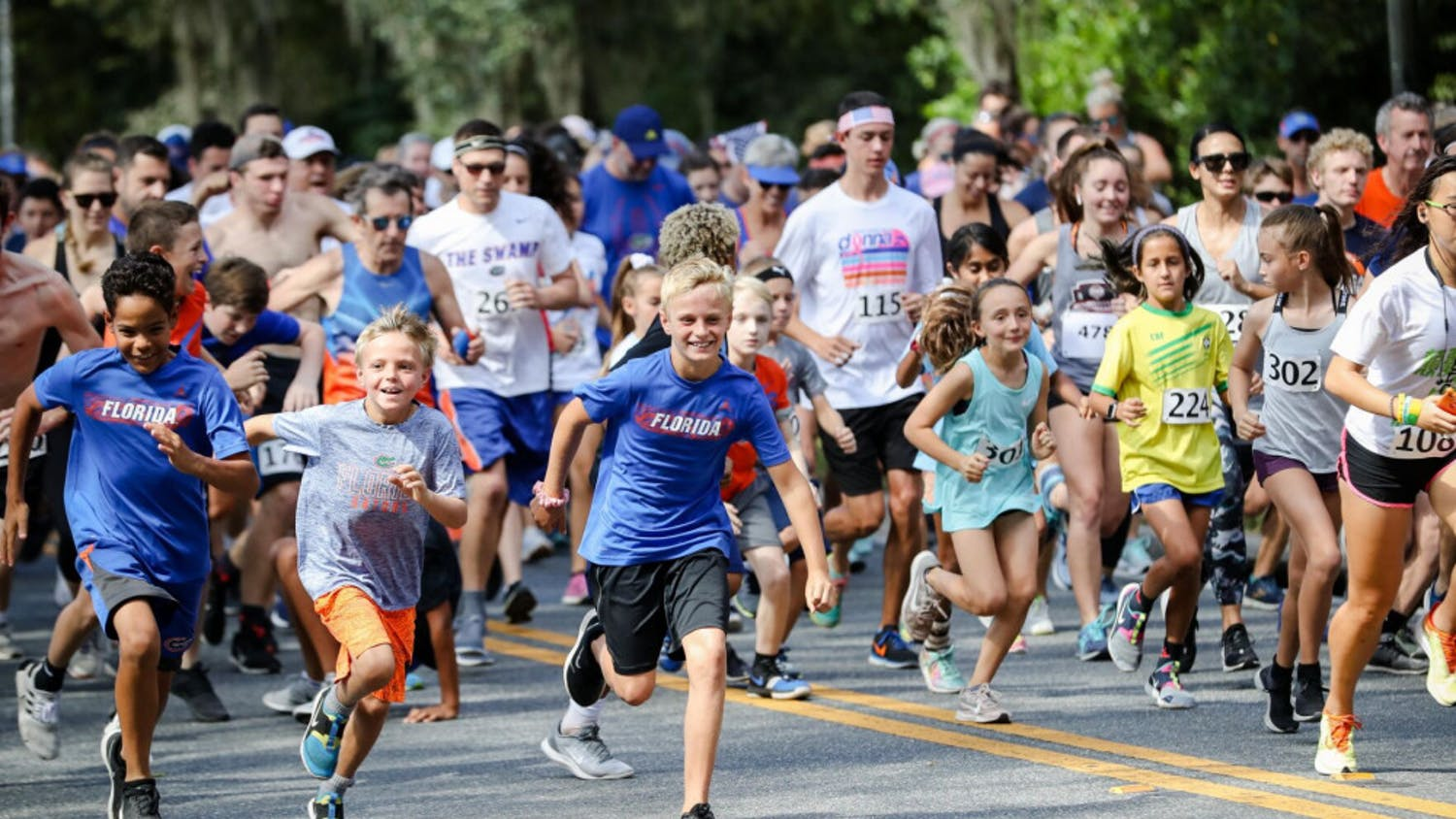 Participants run in the Gator Gallop 5k,one of the various events that takes place during homecoming week at UF in Fall 2019. (Photographer: Adler Garfield, 2019 Director of Photography)