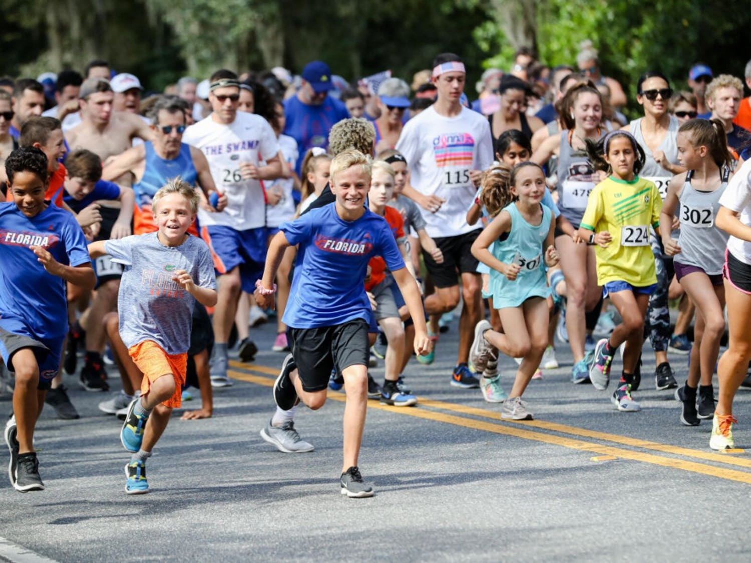 Participants run in the Gator Gallop 5k, one of the various events that takes place during homecoming week at UF in Fall 2019.  (Photographer: Adler Garfield, 2019 Director of Photography)