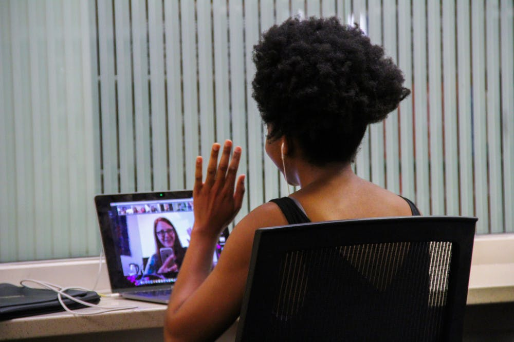 <p>Nomfumo Manaba, a 23-year-old UF journalism and political science junior, video calls into her class at Library West. </p>