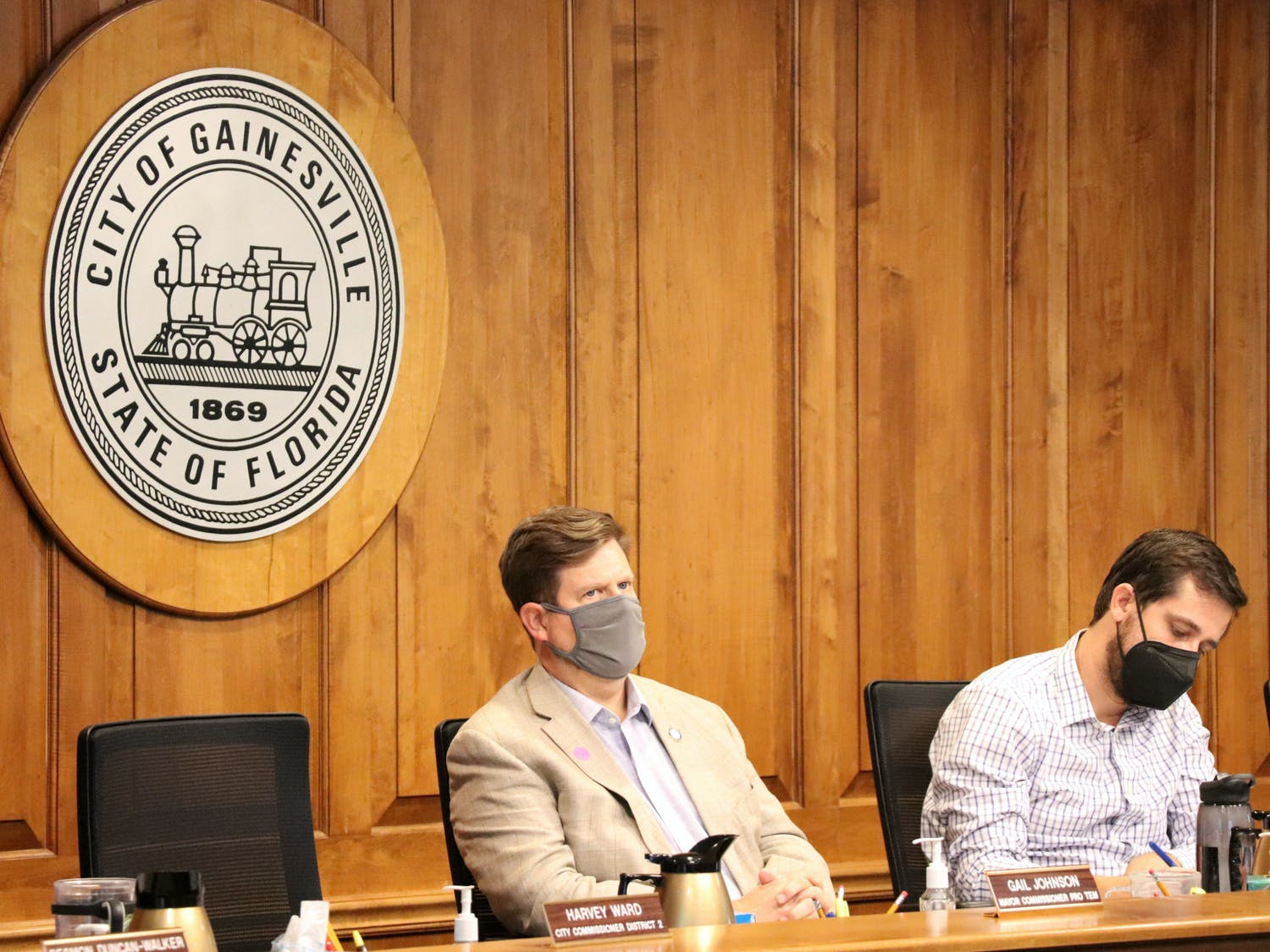 Gainesville Mayor Lauren Poe (left) and City Commissioner Adrian Hayes-Santos (right) listen to public comment at a City Commission meeting on Monday, Sept. 27, 2021.