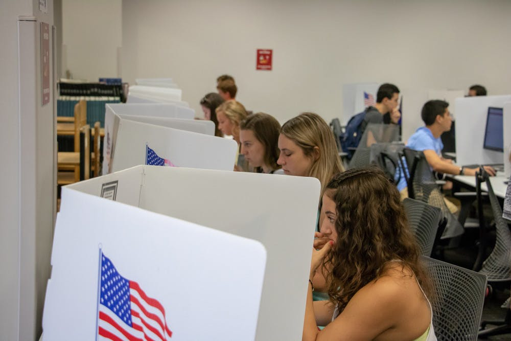 """<p dir=""""ltr""""><span>Students sit at voting stations at the Marston Science Library computer lab polling location and cast their votes for last Fall's Student</span>Government elections on Sept. 25. Marston is one of several locations students can vote at on Wednesday.</p><p><span></span></p>"""