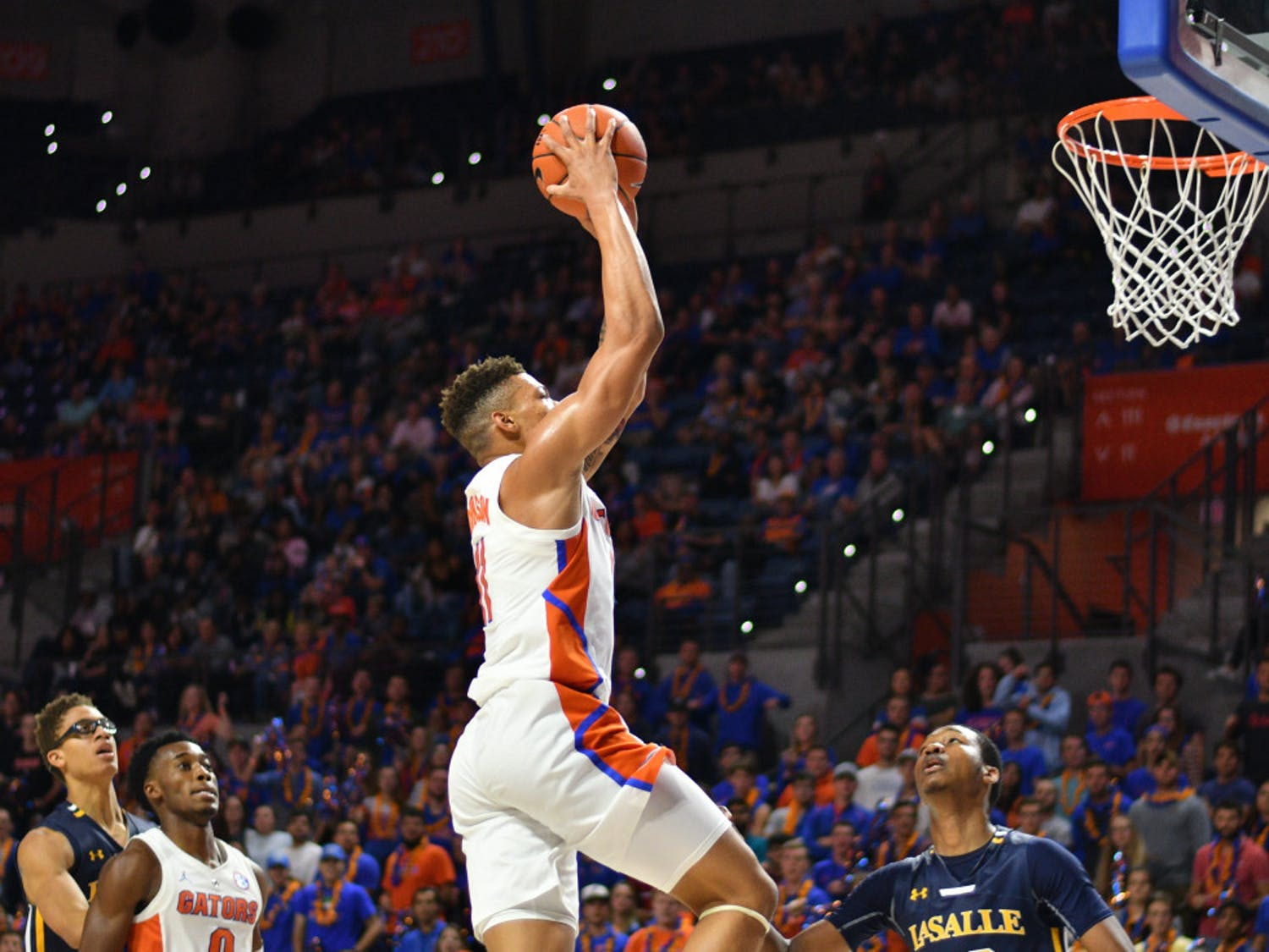 Forward Keyontae Johnson elevates for his thundering dunk against La Salle with 13:40 in the second half. He finished UF's 82-69 victory with 12 points and three rebounds.