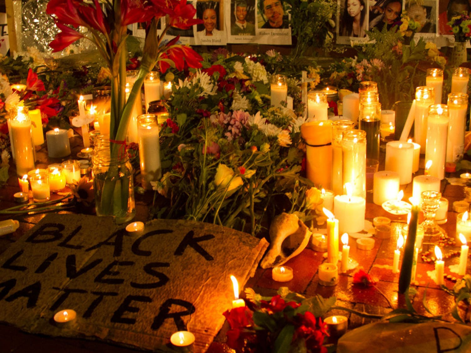 A vigil was held on June 3 in honor of George Floyd and other lives lost from the black community. Attendees grieved before analtar made of flowers, candles and photos of victims.