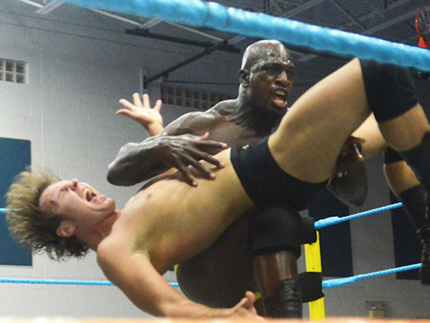 Titus O'Neil, whose real name is Thaddeus Bullard, hits Dean Ambrose with a back breaker at FCW Summer Slamarama at the Martin Luther King Jr. Multipurpose Center Friday.