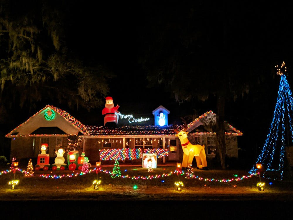 <p>Logan Euler, 19, runs a light show at his dad&#x27;s house in Newberry, Fla. Starting Dec. 3, 2020, cars can tune into a radio station as they drive by to hear the curated music and messages from the show every night  from 6-9 p.m. Sunday-Thursday and 6 p.m. to 12 a.m. on Fridays and Saturdays. </p>