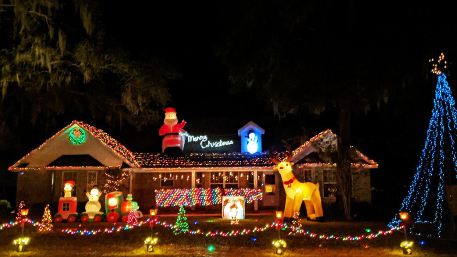 Logan Euler, 19, runs a light show at his dad's house in Newberry, Fla. Starting Dec. 3, 2020, cars can tune into a radio station as they drive by to hear the curated music and messages from the show every night  from 6-9 p.m. Sunday-Thursday and 6 p.m. to 12 a.m. on Fridays and Saturdays.