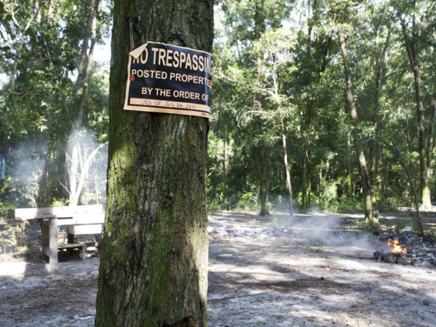 A sign posted by the Gainesville Police declares the date it will start removing unauthorized residents from the property south of Depot Avenue, known as tent city.