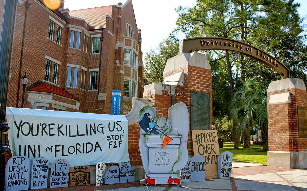 <p>A collection of tombstone shaped signs and a banner calling for the end of in-person classes at the University of Florida was set-up on the corner of 13th Street and University Avenue on Thursday, Feb. 4, 2021.</p>