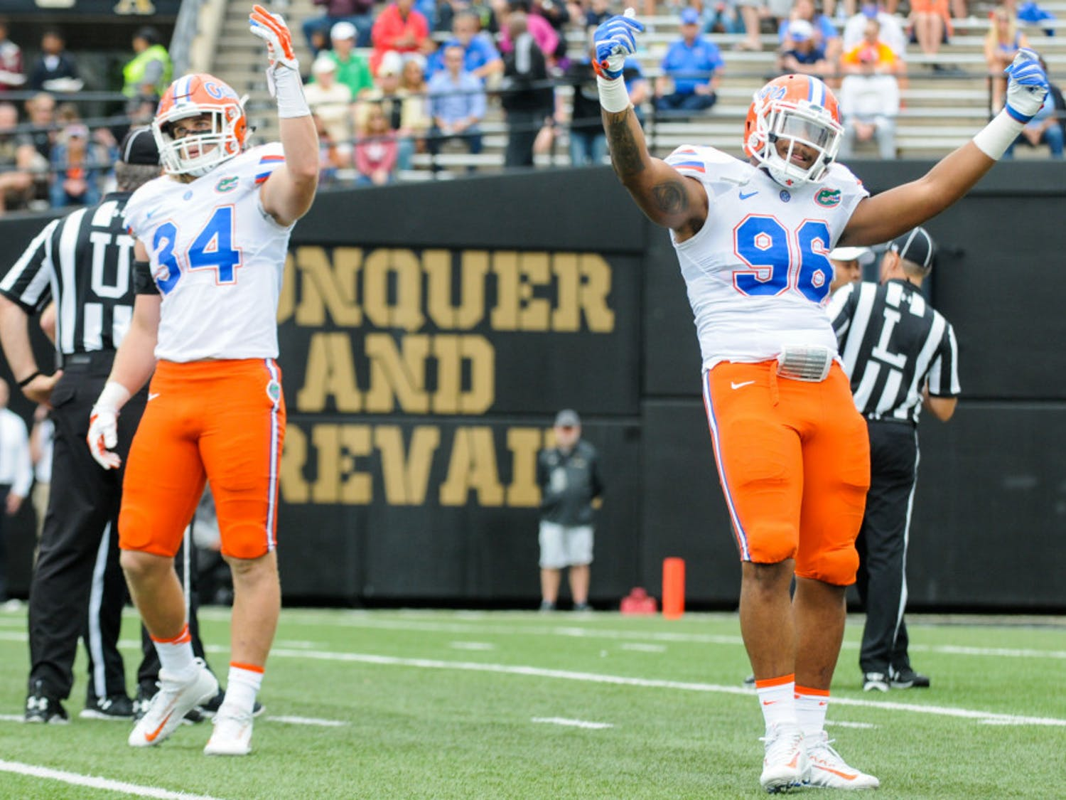 """Alex Anzalone (34) andCeCe Jefferson (96)motion to the crowd during Florida's 13-6 win over Vanderbilt on Oct. 1 in Nashville. """"He doesn't hold anything back,"""" linebacker Jarrad Davis said of Anzalone. """"He lets everything go, and that's what we want from our teammates."""""""