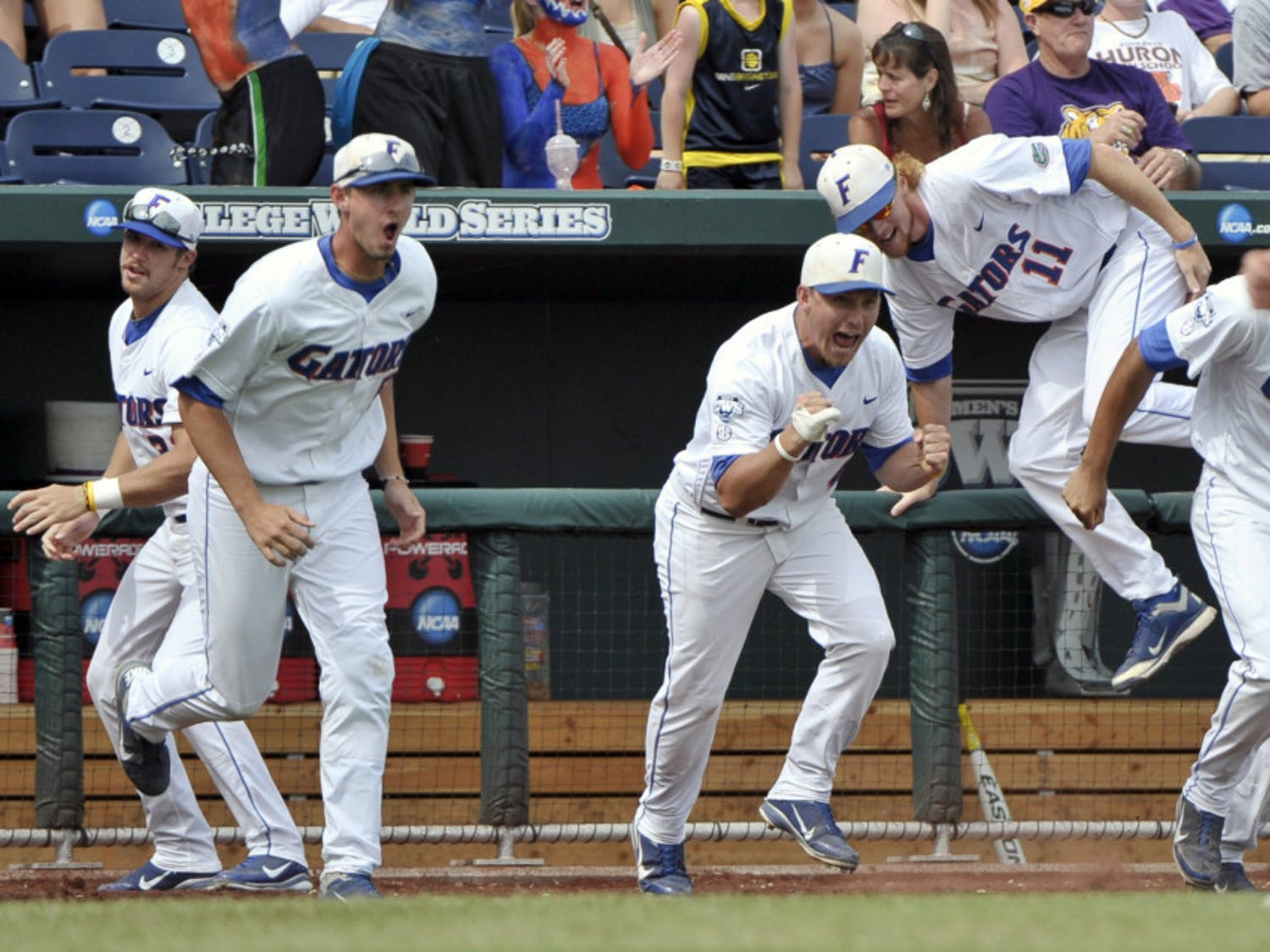 Florida players erupt out of the dugout after defeating Vanderbilt 6-4 to advance to the CWS championship series.