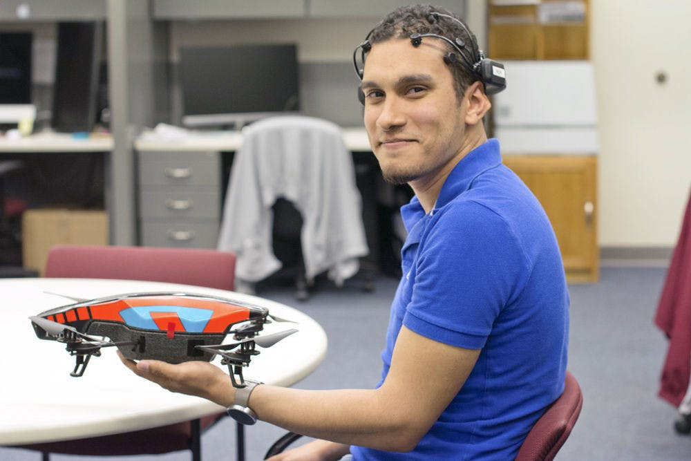 <p>Marvin Andujar, a 25-year-old UF human-centered computing doctoral student, poses for a photo with a mind-controlled drone that he and his partner, Chris Crawford, programmed.</p>