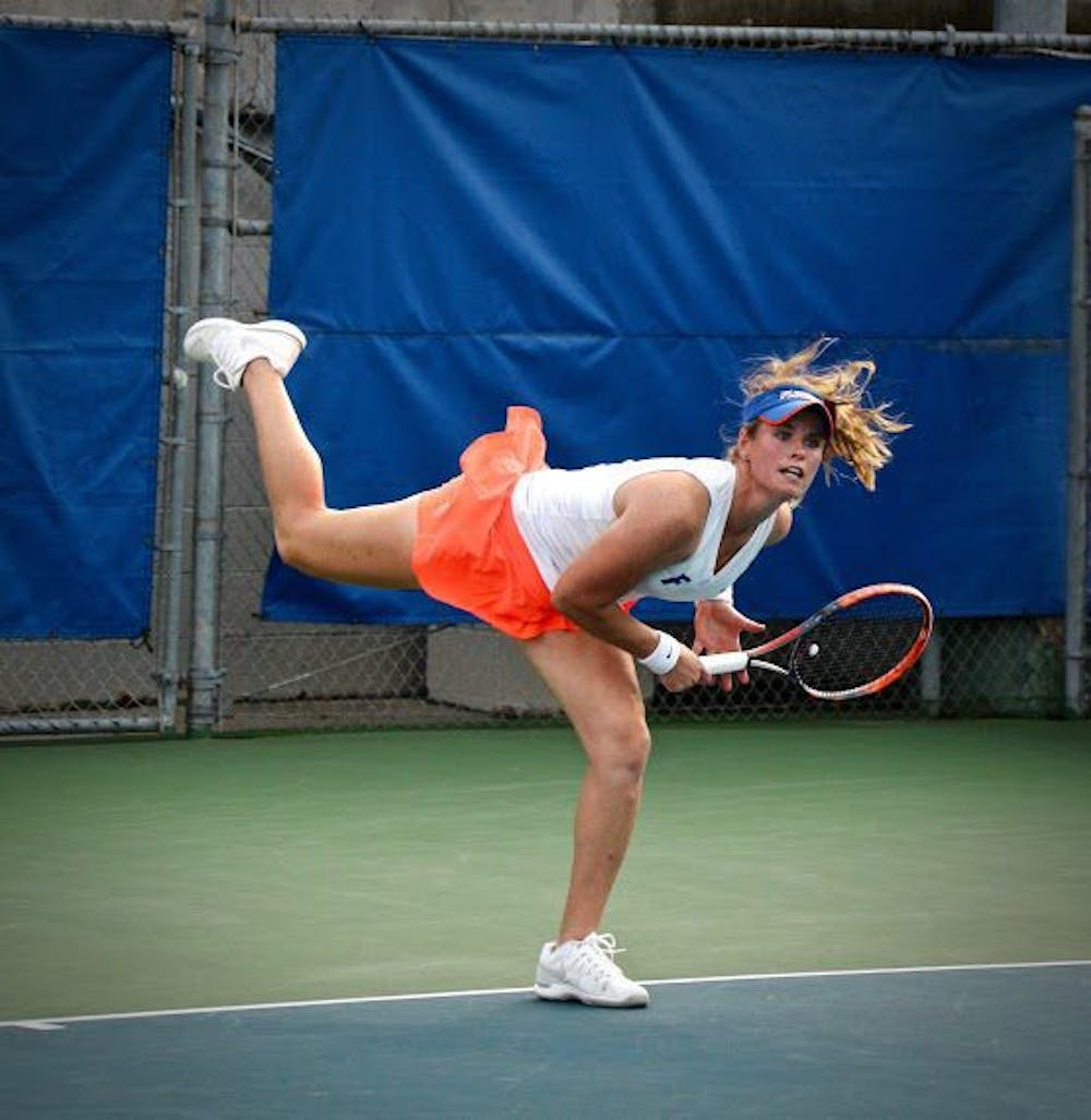 <p>UF's Belinda Woolcock hits a serve during Florida's 4-2 win against Oklahoma State on Feb. 18, 2017, at the Ring Tennis Complex.</p>