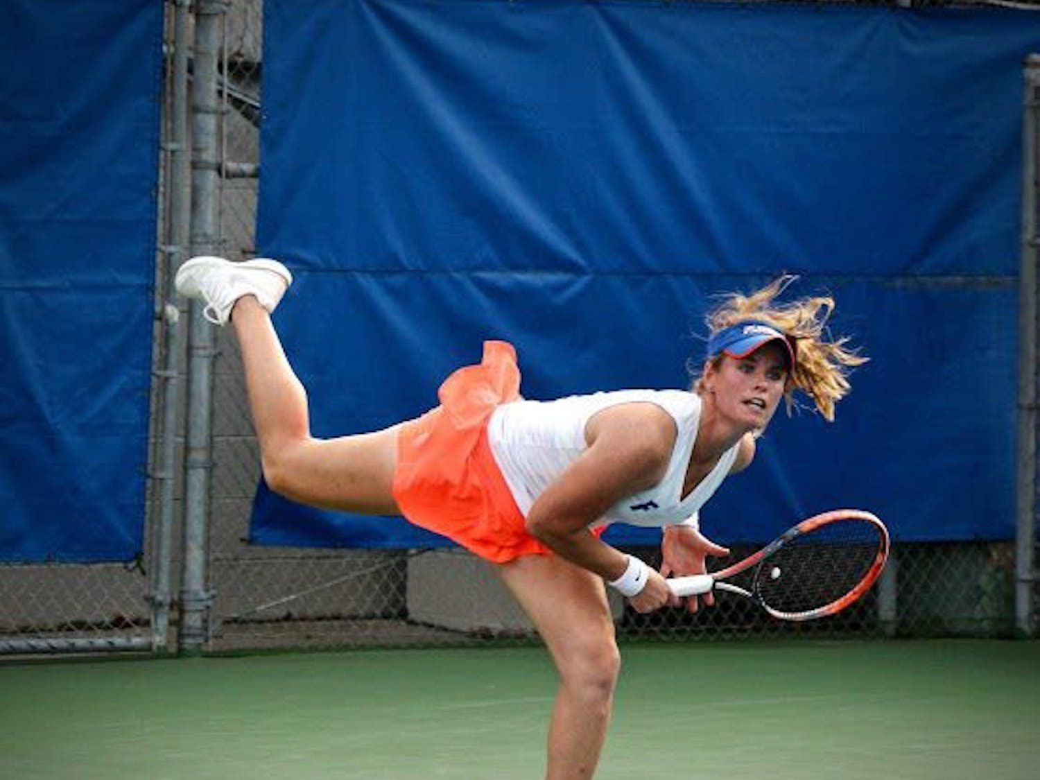 UF's Belinda Woolcock hits a serve during Florida's 4-2 win against Oklahoma State on Feb. 18, 2017, at the Ring Tennis Complex.