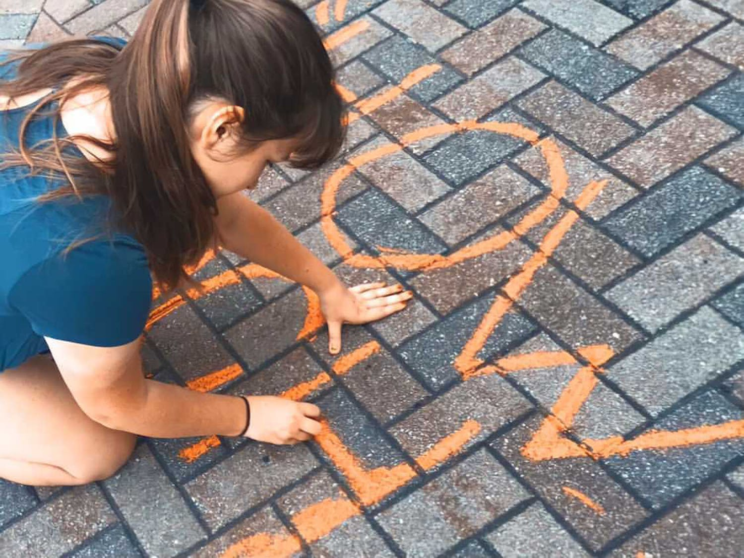 The organization chalks messages on the sidewalks of Gainesville to raise awareness about street harassment.