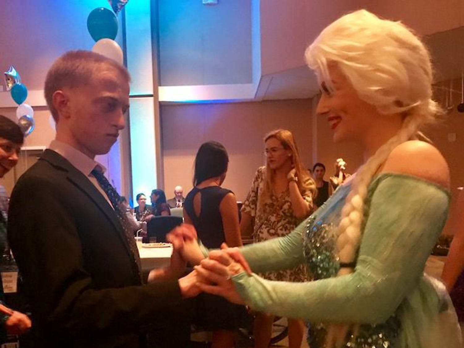 Guest David Ison is dancing with Jeana Fraser, UF sophomore serving with Project Princess as Queen Elsa.