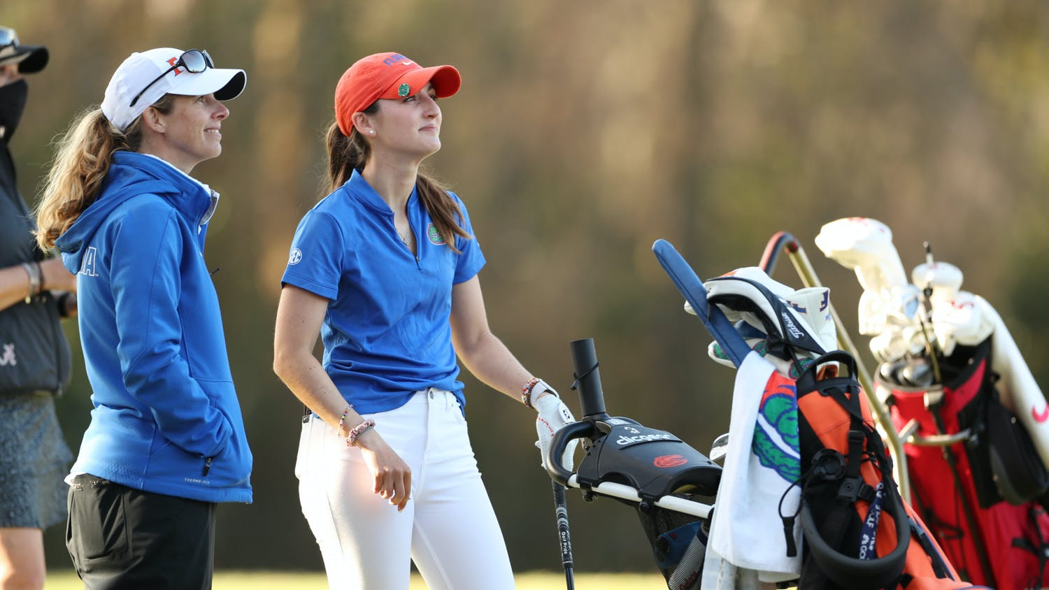 Florida women's golf coach Emily Glaser and Maisie Filler at Mark Bostick Golf Course on Tuesday, February 23, 2021 / UAA Communications photo by Tim Casey