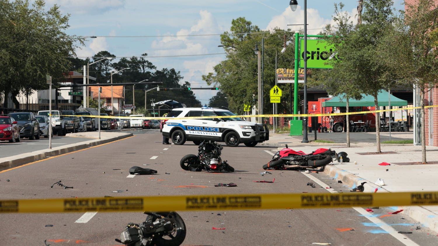 Remnants of a motorcycle accident are seen on the corner of 3rd Avenue and West University Avenue in front of Krispy Kreme on Friday, Oct. 1, 2021.