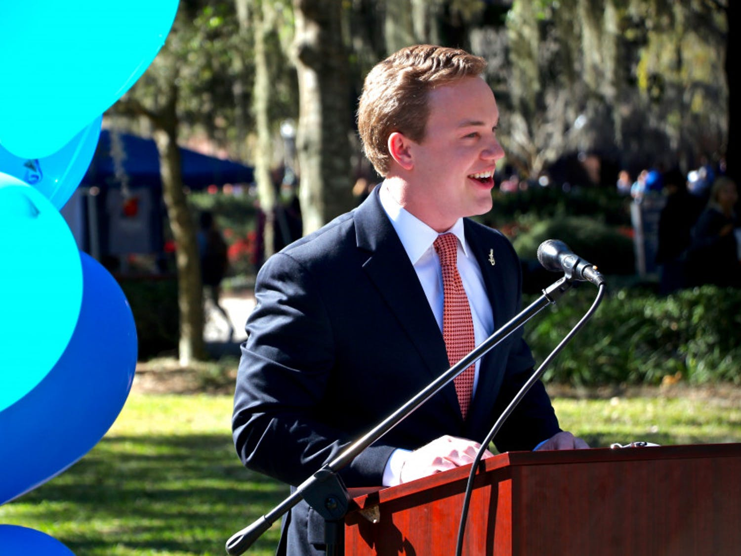"Smith Meyers, a 22-year-old UF food and resource economics senior and the Impact Party candidate for Student Body president, delivers his acceptance speech in front of Century Tower for a crowd of more than 50 people. Meyers stated that ""character is what will guide how I lead this campus forward."""