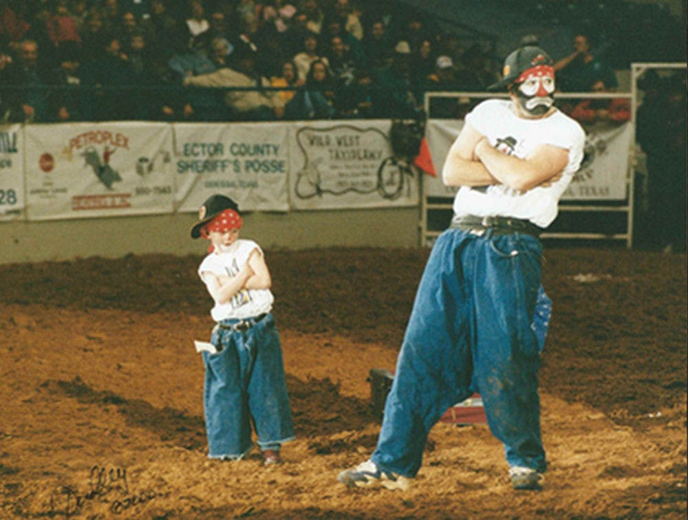 <p>Rodeo clowns Hollywood Harris and his son, Boogerhead, perform a skit in which Harris pulled boogerhead out of a suitcase. Now 22, Boogerhead goes by the name Brinson James the Entertainer. He has been performing with his dad since he was 2.</p>