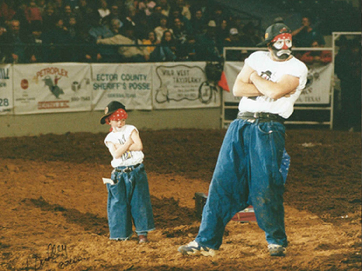 Rodeo clowns Hollywood Harris and his son, Boogerhead, perform a skit in which Harris pulled boogerhead out of a suitcase. Now 22, Boogerhead goes by the name Brinson James the Entertainer. He has been performing with his dad since he was 2.
