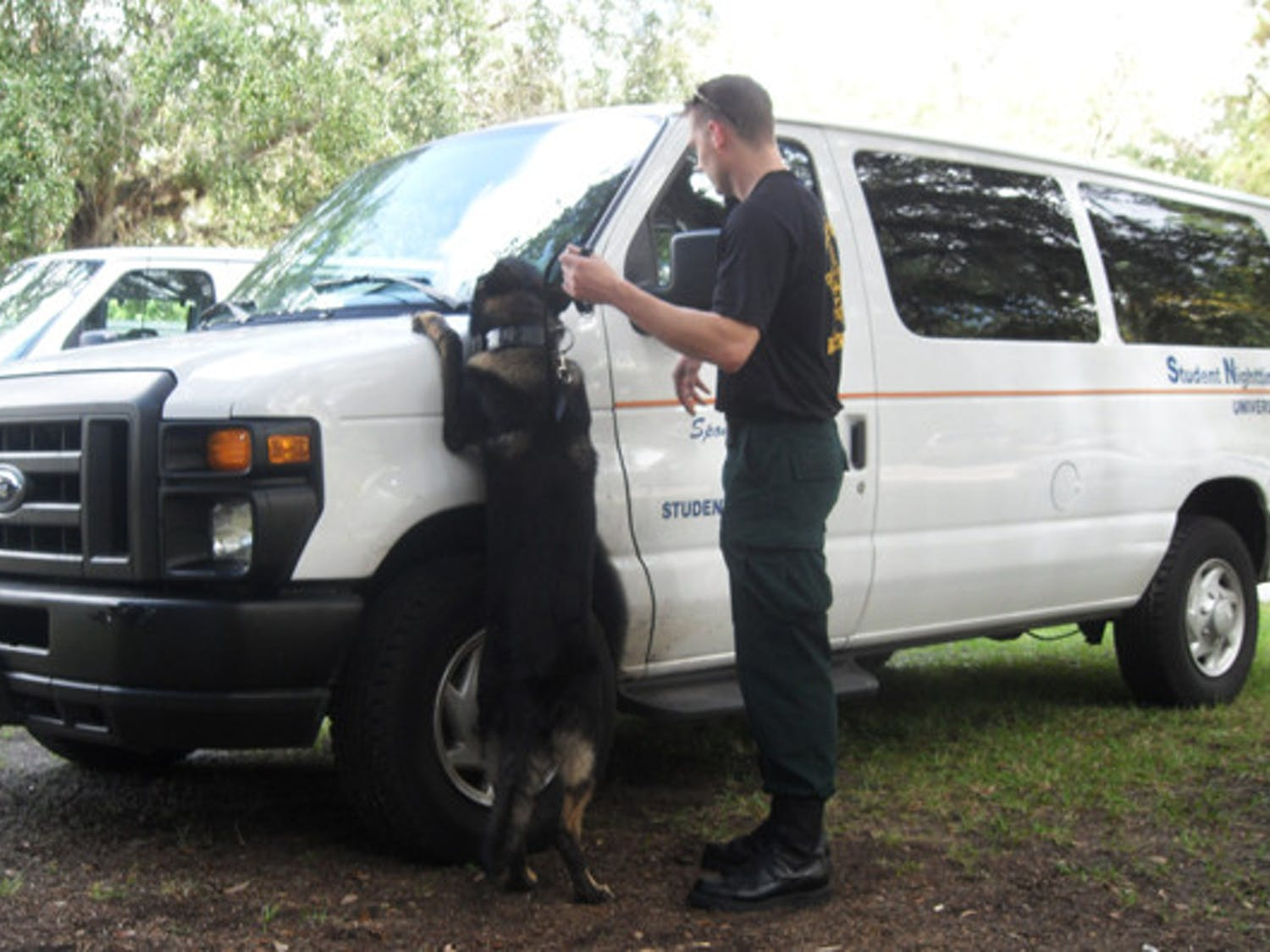 A German shepherd police dog, Apollo, is led by Marion County Sheriff's Office Deputy Greg Combs Friday, sniffing out narcotics for his yearly certification requirements.