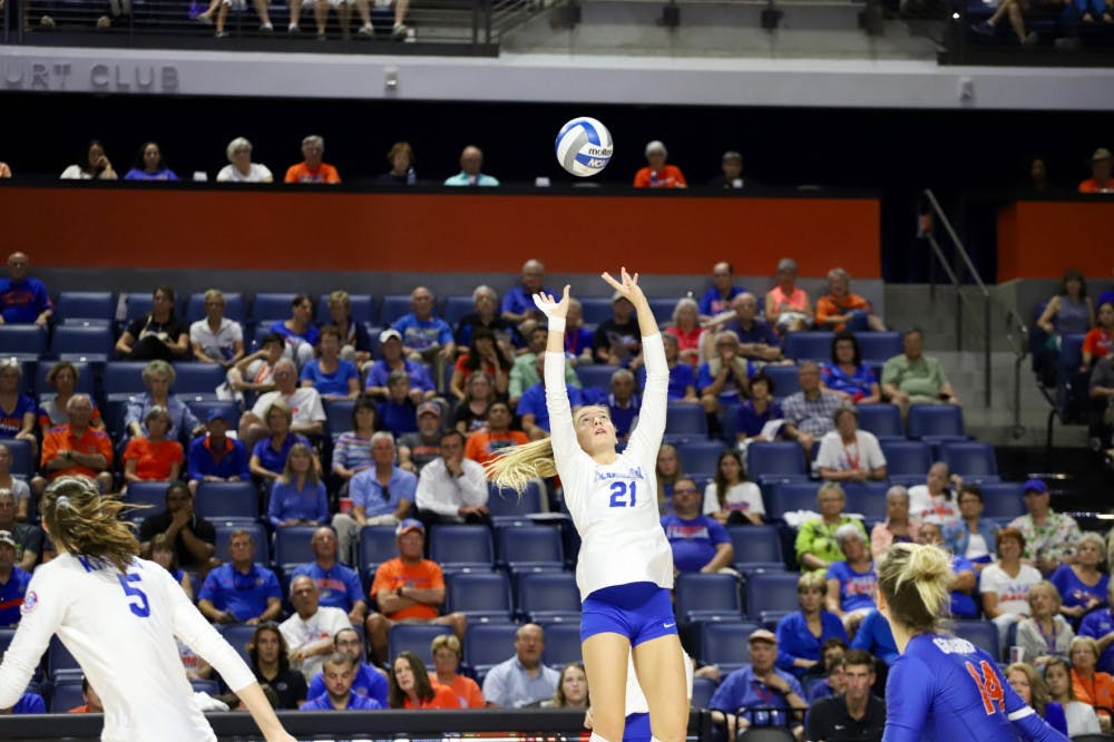 Florida's Marlie Monserez offers up a set during a game in 2019.