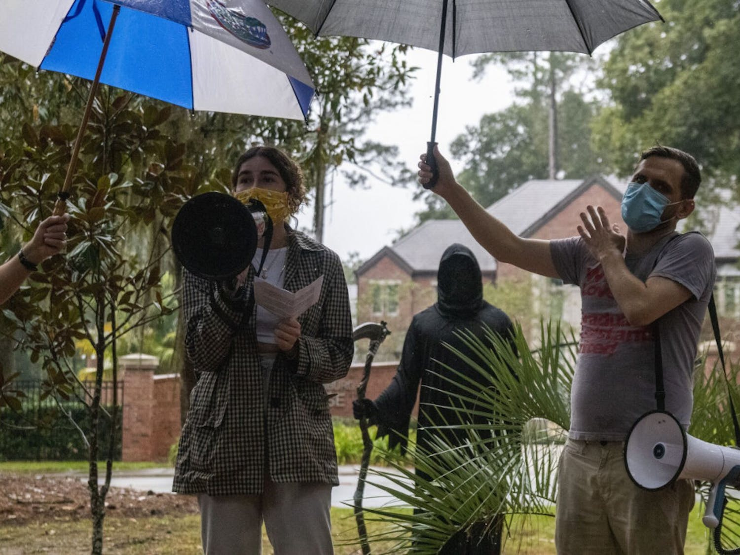 Cristina Cabada, the Alachua County Labor Coalition Coordinator, speaks to a crowd assembled across the street from the Dasburg House during a protest against in-person classes this spring at UF, on Sunday, Nov. 1, 2020.