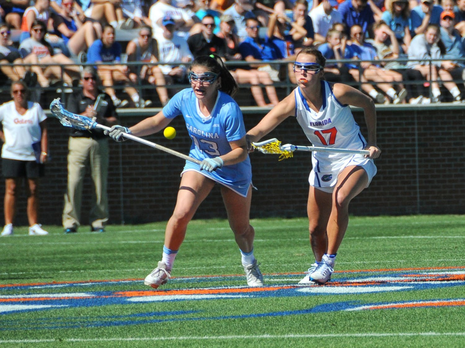 UF attacker Mollie Stevens fights off a North Carolina player during Florida's 13-10 loss to the Tar Heels on Feb. 11, 2017, at Donald R. Dizney Stadium.