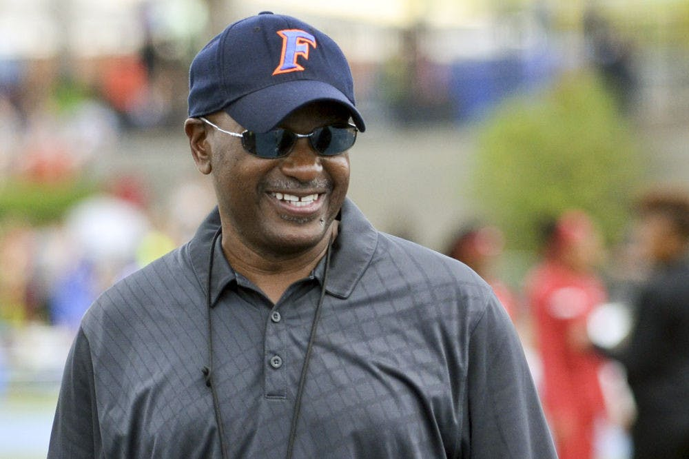 <p>UF coach Mike Holloway smiles during the 2015 Florida Relays at James G. Pressly Stadium.</p>