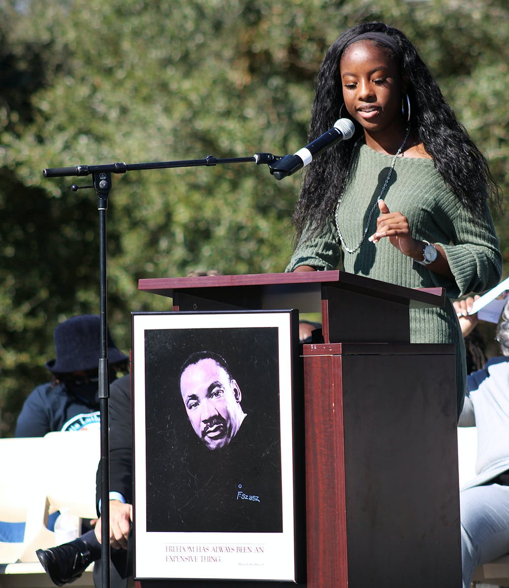 Taylor Hill-Miles, this year's winner of the Edna M. Hart Keeper of the Dream Award, gives a keynote speech at Citizens Field on Martin Luther King Jr. Day. She talked about the importance of demanding justice for the Black community.